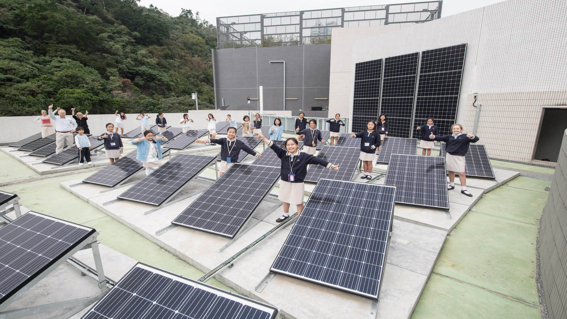 students standing around large solar panels